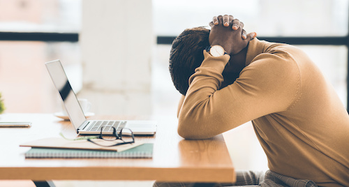 employee suffering from work related burnout